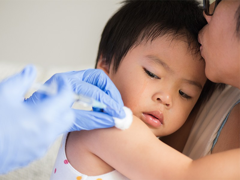 Child receives a vaccine shot